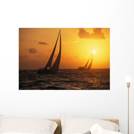 Hawaii, Two Sailboats Silhouetted At Sunset, Yellow And Orange Skies Wall Mural