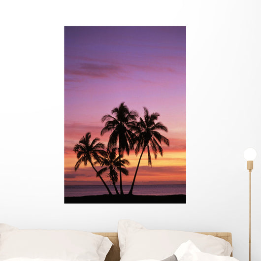 Cluster Of Palm Trees With Beautiful Sunset Background Wall Mural