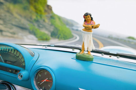 Plastic Hula Doll On The Dashboard Of A Turquoise Thunderbird Wall Mural