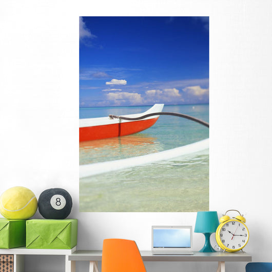 Red And White Outrigger Canoe Floating On Calm Turquoise Water Wall Mural