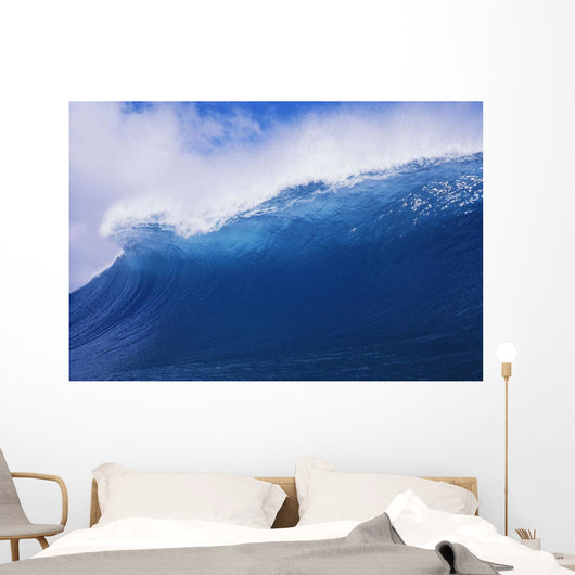 Blue Wave Curling Over Forming Barrel With White Waters Wall Mural