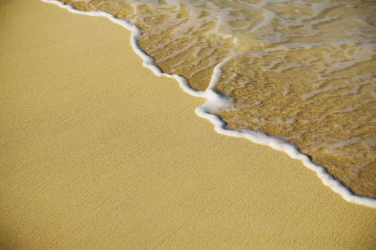 Close-Up Of Gentle Waves Washing Onto Sandy Tropical Beach Wall Mural