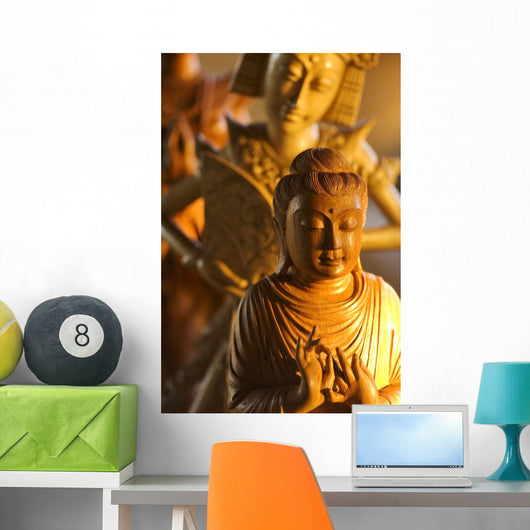 Myanmar, Statue Of A Wooden Budha, Indonesian Dancer Statue Behind Wall Mural