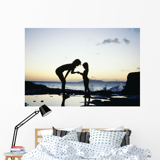 Mother And Daughter Silhouetted In Tidepool At Sunset Wall Mural