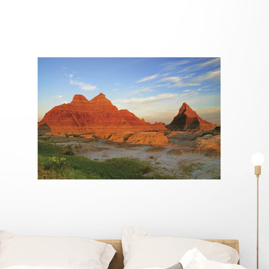 A Red Sunrise Illuminates The Hills In Badlands National Park Wall Mural