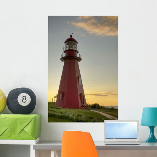 Red Lighthouse At Sunset Wall Mural
