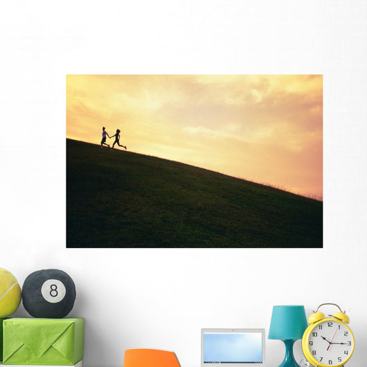 Hawaii, Couple Running Along A Hill At Sunset Wall Mural