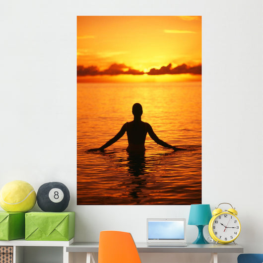Silhouette Of Woman Wading In The Ocean At Sunrise Wall Mural