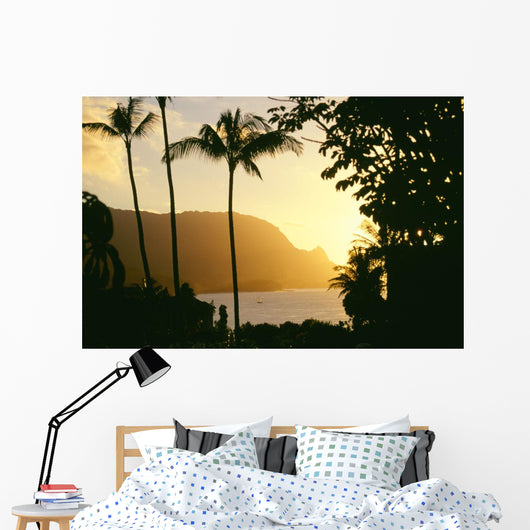 Yellow Sunset Through Palm Trees And Vegetation Wall Mural