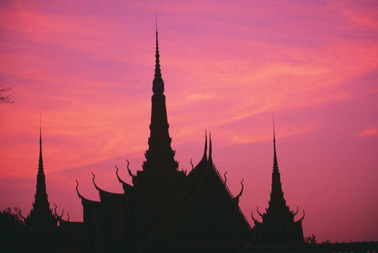 Cambodia, Phnom Phen, Silhouette Of Palace Architecture At Sunset Wall Mural