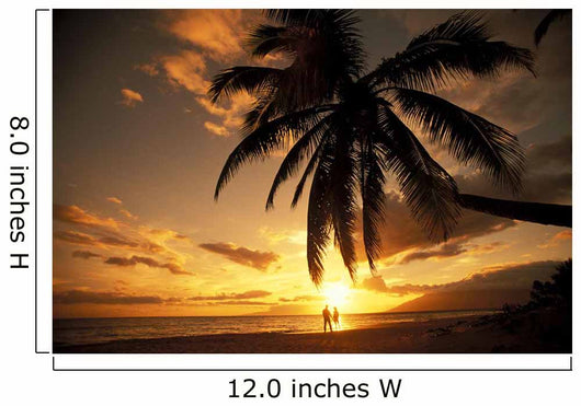 Distant View Of Couple Walking Along Beach At Sunset Wall Mural