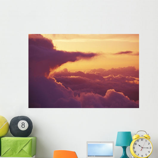 Light Orange Sky With Pink Afternoon Cloud Formations Wall Mural