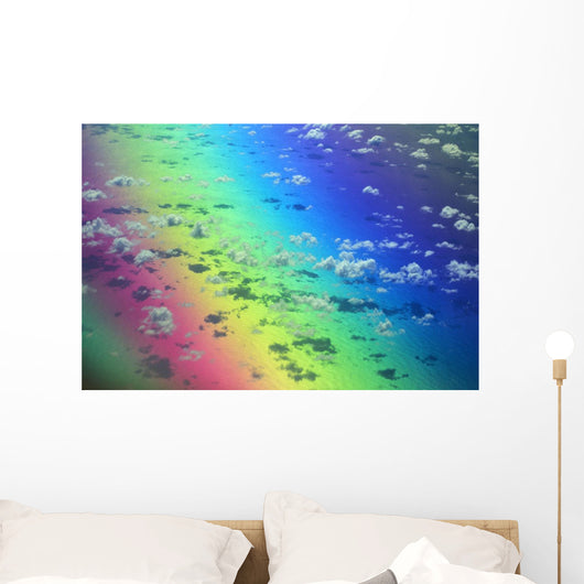 Polarized Rainbow And Aerial Of Clouds Over The Ocean Wall Mural