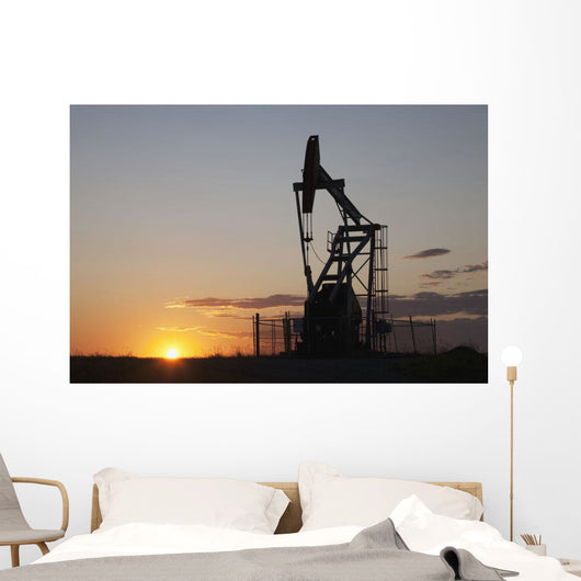 Silhouette Of Pump Jack With The Orange Glow Of The Sun Rising Wall Mural