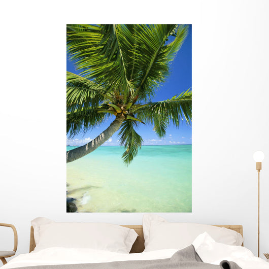 Beautiful View Of Clear Water, Palm Tree, Deep Blue Sky Wall Mural