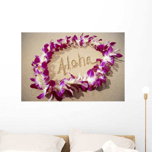 Close-Up Detail Of Purple Orchid Lei On Beach Aloha Written Wall Mural