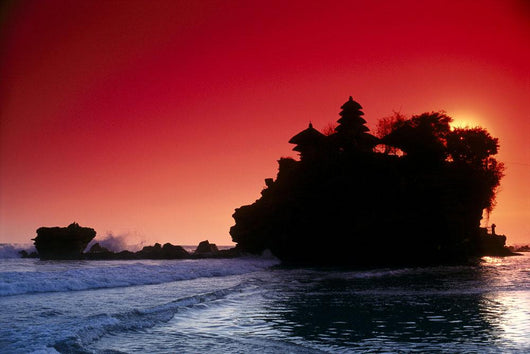 Indonesia, Bali, Tanah Lot Silhouetted By Dramatic Red Sunset Skies Wall Mural