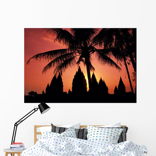 View Of Palm Trees And Buildings Silhouetted At Sunset Wall Mural