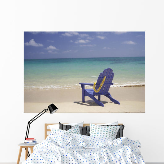 Plumeria Lei Hanging Over Blue Beach Chair Along Shoreline Wall Mural