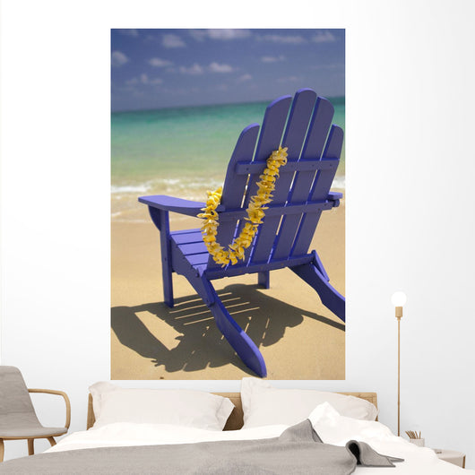 Close-Up Blue Beach Chair With Plumeria Hanging On Side Facing Ocean Wall Mural