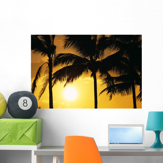 Hawaii, Palm Trees Silhouetted At Sunset, Sun Hangs Low In Sky Wall Mural