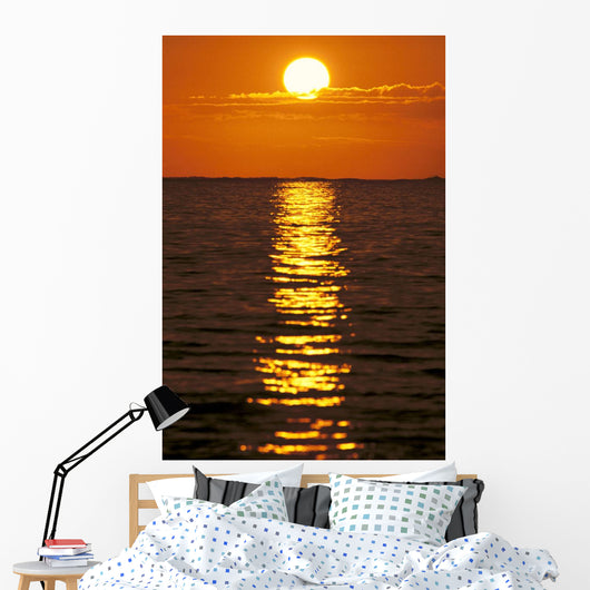 Sunset Reflections On Dark Ocean Water, Sun Ball In Orange Sky Wall Mural