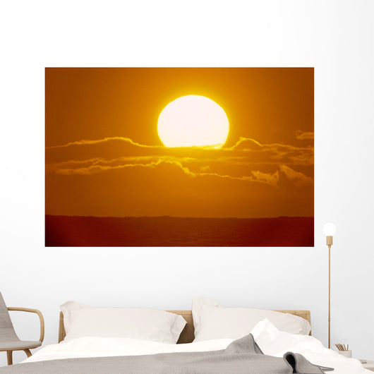 Glowing Sun Ball Partially Covered With Clouds Wall Mural