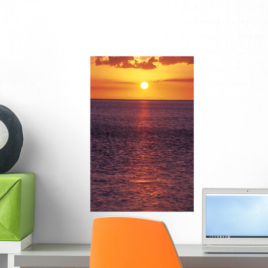 Sunset With Orange Sky Over Ocean Purple Surface With Reflections Wall Mural
