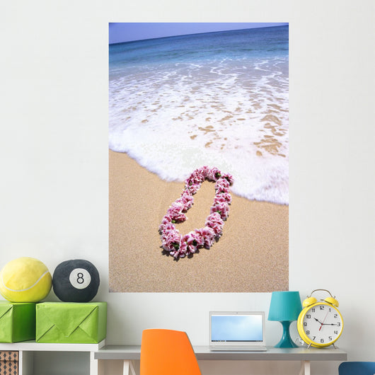 Close-Up Of Pink Lei In Sand On Beach, Foaming Shore Waters, Blue Sky Wall Mural