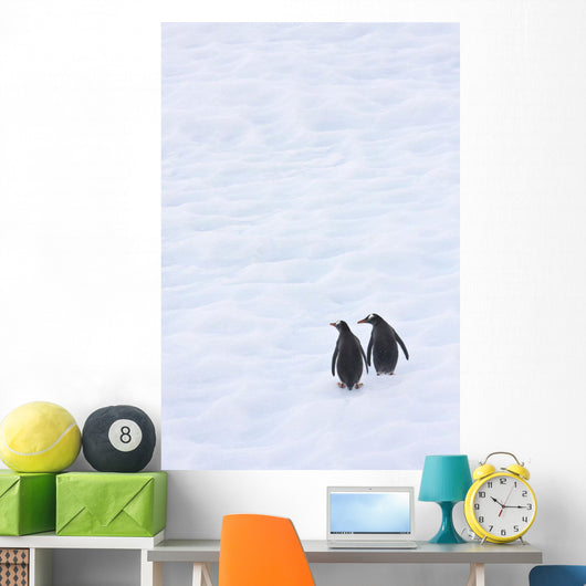 Gentoo Penguins Climb The Side Of An Iceberg Floating In Neko Harbour Wall Mural