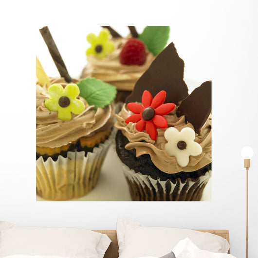 Close-Up Of Three Chocolate Cupcakes With Candy Flowers Wall Mural