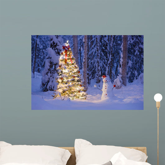 Snowman With Santa Hat Hanging Ornaments On A Christmas Tree Wall Mural