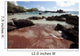 Hawaii, Maui, Hana, A sunny view of Koki Beach on a calm day Wall Mural