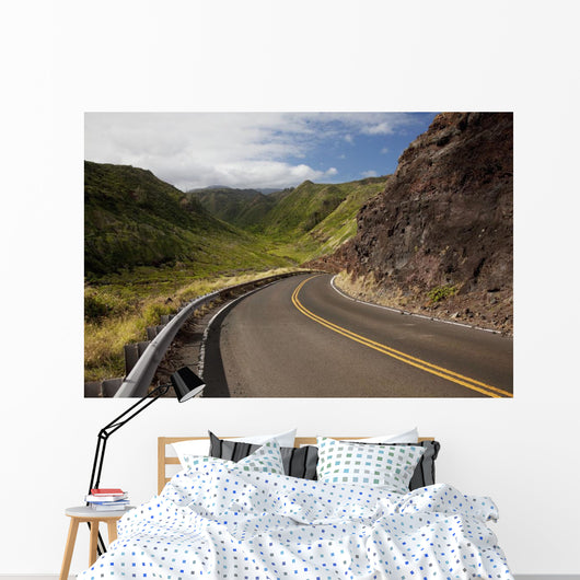 A winding road through Maui's west side with lush mountains Wall Mural