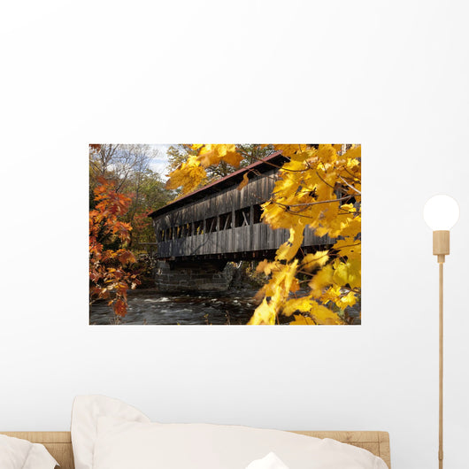 A covered bridge over a river in Autumn Wall Mural