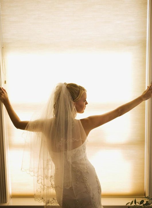 A Bride Pondering Her Big Day While Looking Out A Window Wall Mural