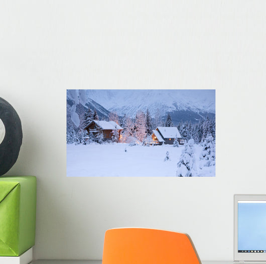 Two Snowcovered Homes In A Wintry Meadow At Dawn With Inside Lights On Wall Mural