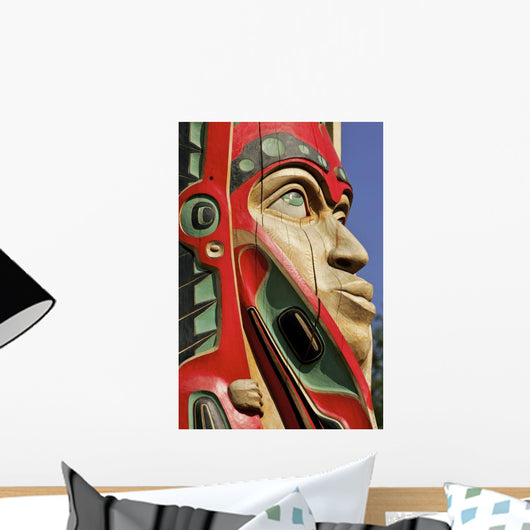 Close Up Of A Face On A Traditional Haida Totem Carving In Ketchikan Wall Mural