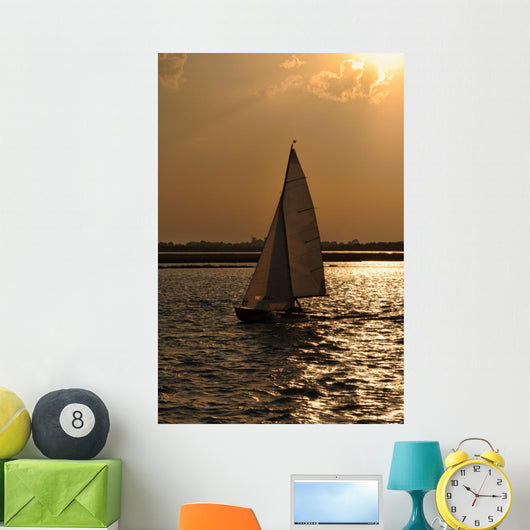 Silhouette of a Sailing Boat at Sunset Wall Mural
