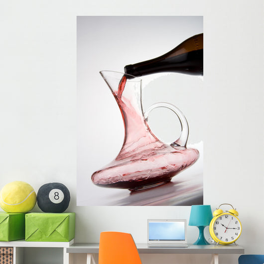 pouring red wine into decanter Wall Mural