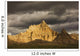Dramatic light during a storm in badlands national park Wall Mural