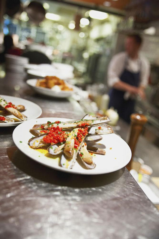 Razor clams on a plate in a restaurant Wall Mural