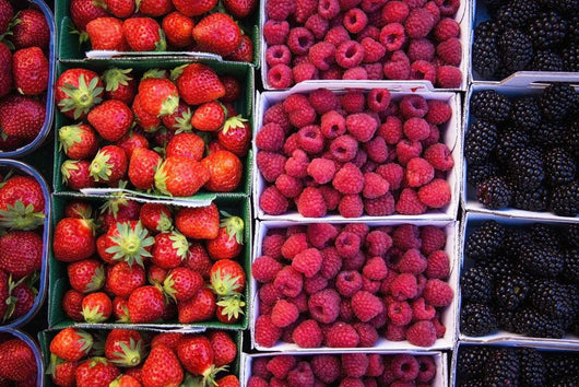 Berries in boxes at a food market;Sault vaucluse provence france Wall Mural