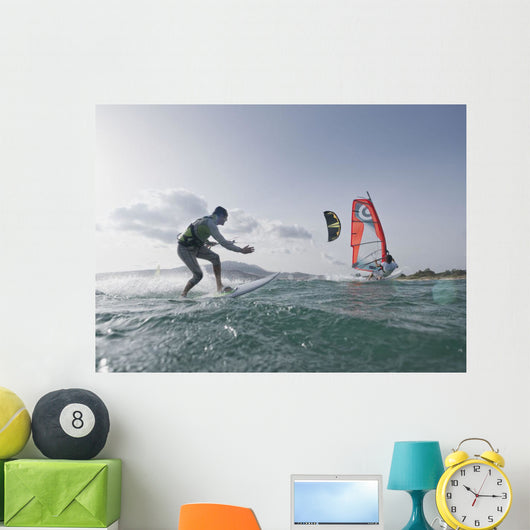 Kitesurfer and windsurfer along the coast Wall Mural