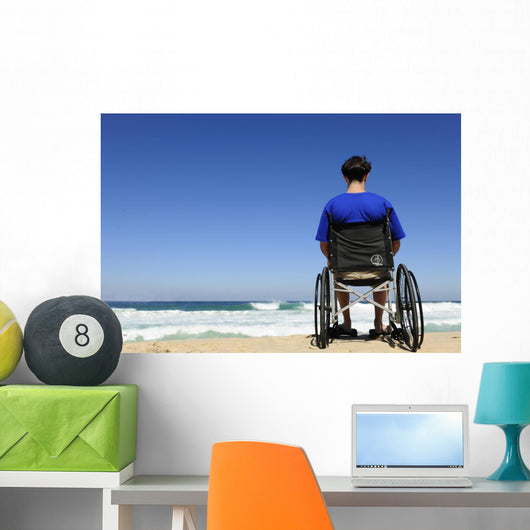 man in a wheelchair watching the sea Wall Mural