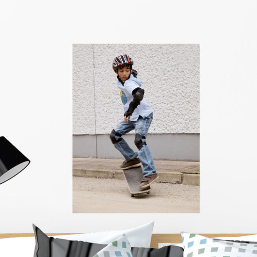 child skateboarding with helmet, knee pads and elbow protection Wall Mural
