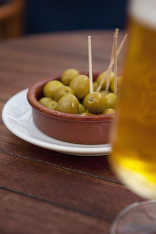 Spain, Majorca, Beer and olives in cafe Wall Mural