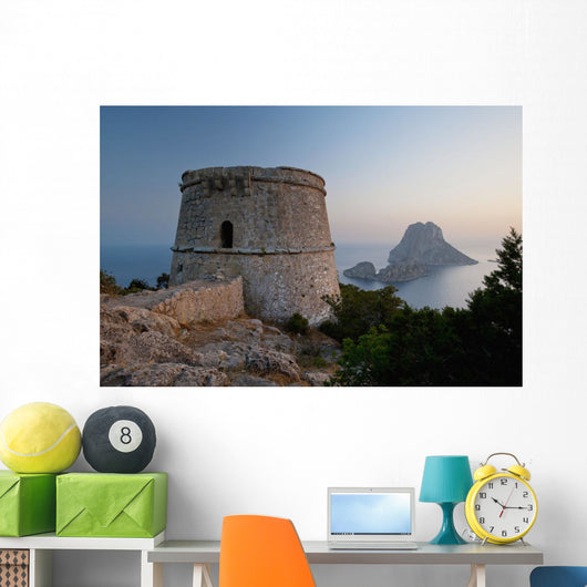 Spain, Torre des Savinar and Es Vedra island at sunset Wall Mural