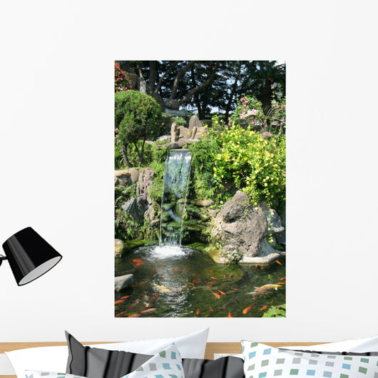 Waterfall and Koi pond in an Asian garden Wall Mural