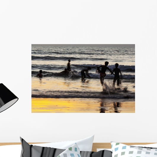 India, Karnataka, Blurry Figures In Crashing Waves At Gokarna Beach Wall Mural